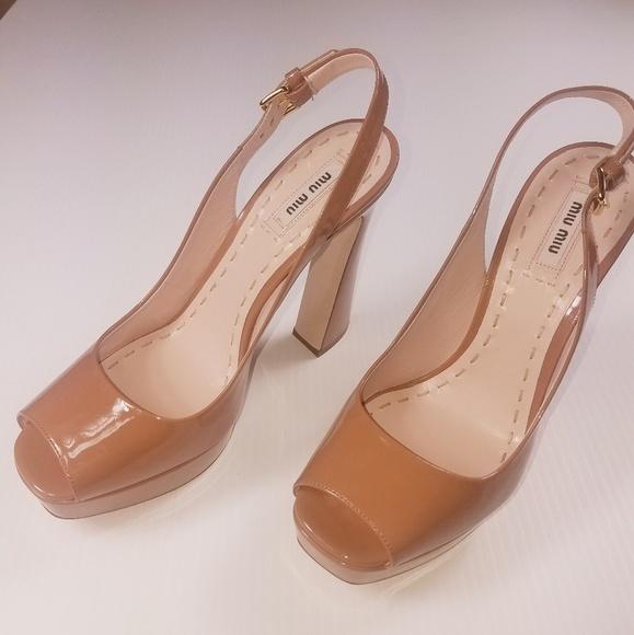 a29a2b76927 Miu Miu women s flared heel nude peep toe pumps